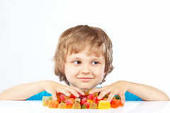 Boy with sweets and candies on white background Royalty Free Stock Images