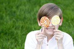 Boy with sweets on a lolly. Popstick Stock Image