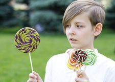 Boy with sweets on a lolly. Popstick Stock Photo
