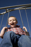 Boy on swigng blue sky Stock Photo