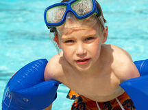Boy with swim floats and mask