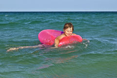 Boy in a swim ring has fun Stock Images