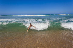 Boy Swim Shorebreak Wave royalty free stock photo