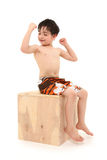 Boy in Swim Suit Sitting on wooden Box stock photography