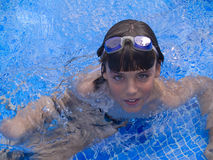 Boy swiming. In blue pool Royalty Free Stock Photography