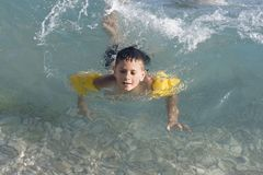 Boy swiming. Happy boy swiming in sea Stock Photo