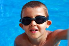 Boy in swiming pool Royalty Free Stock Photography