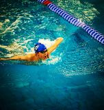 Boy swiming at sport pool. Young boy sportsman Royalty Free Stock Photography