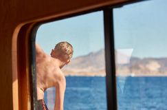 Boy swiming at red sea Stock Images