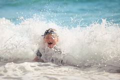 The boy swiming in sea waves Royalty Free Stock Photography