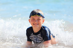 The boy swiming in sea waves Royalty Free Stock Images
