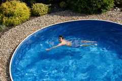 Boy swimm in pool Royalty Free Stock Images