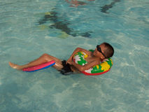 Boy swimming. A little asian boy in swimming pool Stock Photo