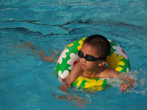 Boy swimming stock images