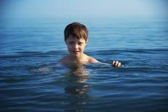 Boy swimming Stock Photography