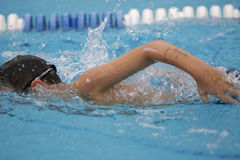 Boy swimming. The crawl during a youth swim meet Royalty Free Stock Photography