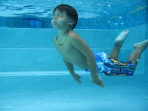Boy swimming Stock Photos