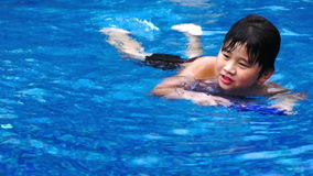Boy swimming stock video footage