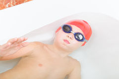 Boy swimming in bathtub Royalty Free Stock Photo