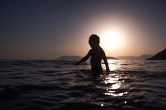 Boy Swimming on Body of Water Royalty Free Stock Images