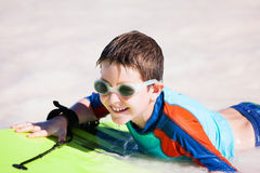 Boy swimming on boogie board Stock Photo