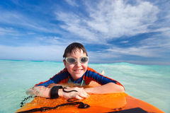 Boy swimming on boogie board Royalty Free Stock Photography