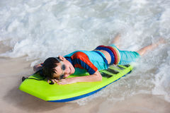 Boy swimming on boogie board. Little boy on vacation having fun swimming on boogie board royalty free stock images