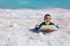 Boy swimming on boogie board Royalty Free Stock Image