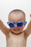Boy with swimming goggles. A chinese boy portrait, with blue swimming goggles, isolated Royalty Free Stock Image