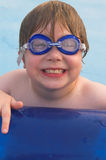 Boy in swimming goggles Stock Photos
