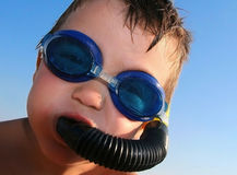 Boy with swimming goggles against blue sky Royalty Free Stock Photography