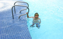 Boy swimming with googgles Stock Images