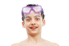 Boy in swimming mask with a happy face portrait, isolated on white. Boy diver in swimming mask with a happy face portrait, isolated on white background Stock Photo