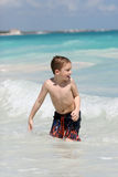 Boy swimming in ocean Stock Image