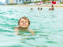 Boy is swimming in the ocean Royalty Free Stock Images