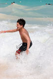 Boy swimming in ocean waves. On heavy surf Royalty Free Stock Photo