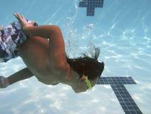 Boy swimming in pool Stock Photo