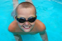 Boy in swimming pool. Young boy having fun in the swimming pool Royalty Free Stock Images