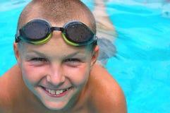 Boy in swimming pool. Young boy having fun in the swimming pool Stock Image