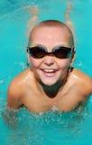 Boy in swimming pool. Young boy having fun in the swimming pool Stock Photos