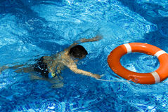 Boy in the swimming pool royalty free stock photo