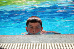 Boy in swimming in the pool Stock Photos