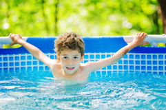 Boy in a swimming pool. Six year old boy in an outdoor swimming pool Stock Photos