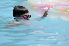 Boy in swimming in the pool Royalty Free Stock Photography