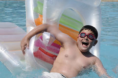 Boy in swimming in the pool Royalty Free Stock Photo