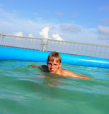 Boy in swimming pool Royalty Free Stock Photo