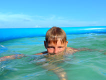 Boy in swimming pool Royalty Free Stock Photography