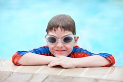 Boy at swimming pool Stock Photo