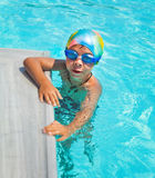 Boy in a swimming pool Royalty Free Stock Photos