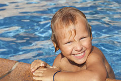 Boy is in the swimming pool Royalty Free Stock Photography